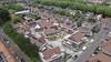 Kapitale huizen De Cuyp in Enkhuizen verkocht, koopwoningen op plek gesloopte technische school naderen voltooiing