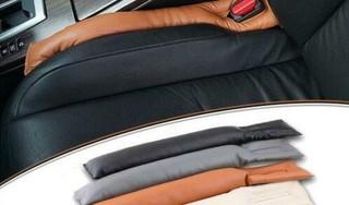 Handige opvulling van de gaten tussen de autostoelen