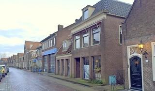 Tien nieuwe appartementen op plek van oude garage in centrum Monnickendam