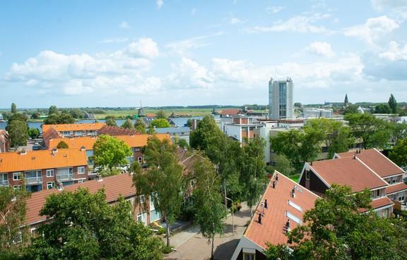 Zonnepark van ZOOZ op platte daken van AAK in Zaandijk: buurt profiteert via bedrijf van zonne-energie