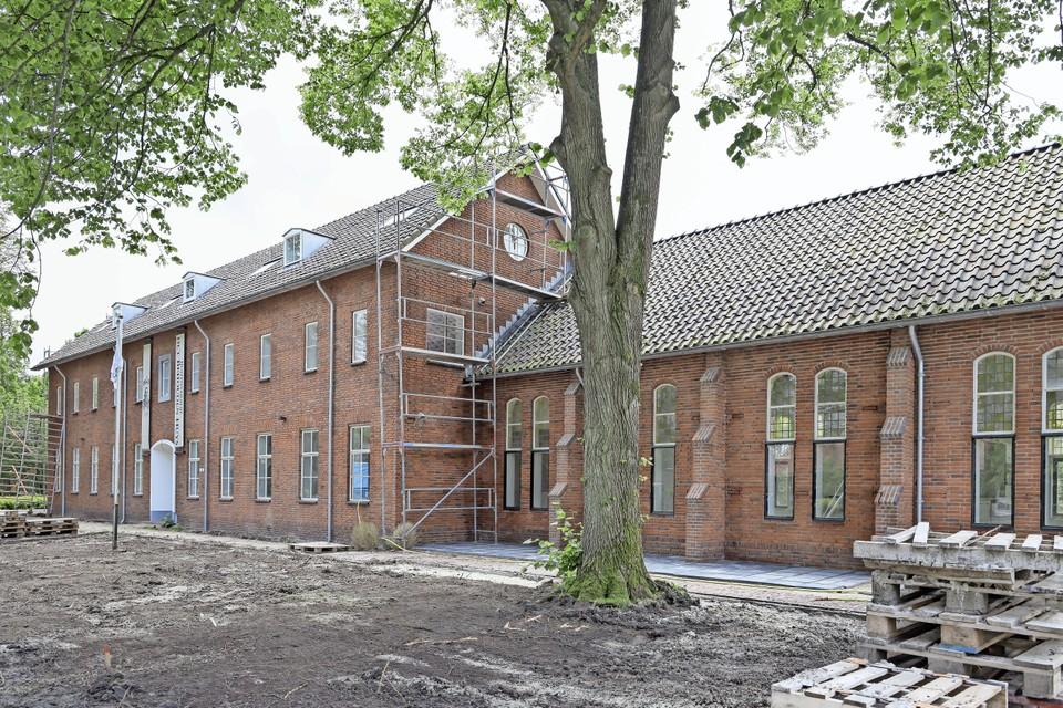 Het vernieuwde Behouden Huys aan de kant van de Tuinstraat. De tuin moet nog worden aangelegd.