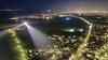 Een zee van lichtjes op deze luchtfoto van Huisduinen, maar de winnaar is de Lange Jaap met zijn imposante lichtstralen