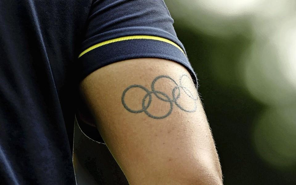 Golfer Gavin Green heeft de ringen op zijn arm.