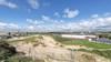 Asbest gedumpt in duinen Wijk aan Zee. Er zijn hekken omheen geplaatst