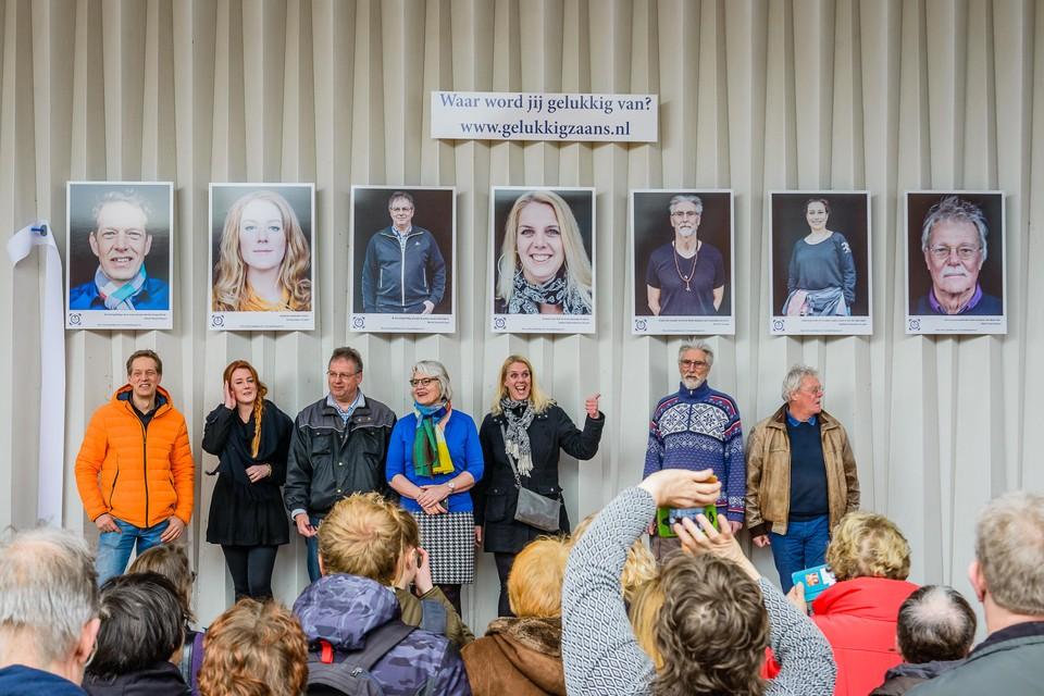 Zeven portretten van Kogers. Alleen Mokhtara Bestevaar ontbreekt. In haar plaats wethouder Visscher.